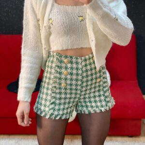 Short verde con bottoni oro