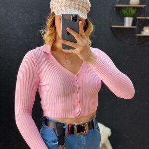 Polo con bottoncini rosa
